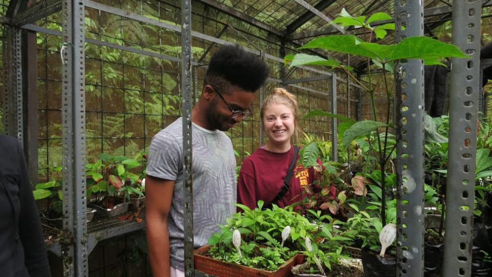 Annie and Akeem in greenhouse